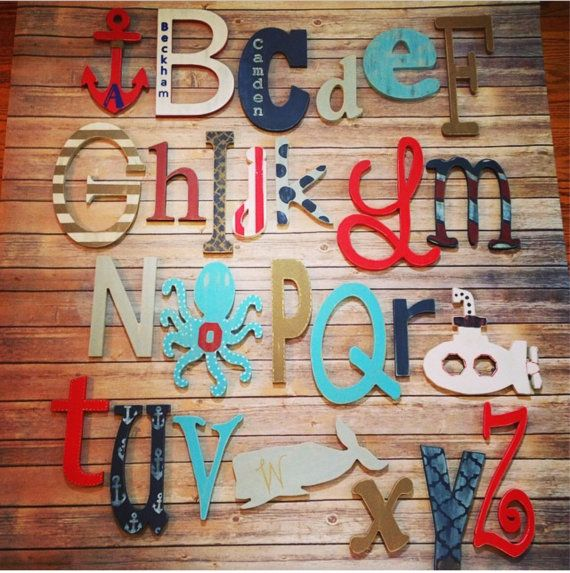 This set of painted nautical wood letters and shapes comes in 4 up to 12. Choose all letters or add shapes as shown with the letter painted/in