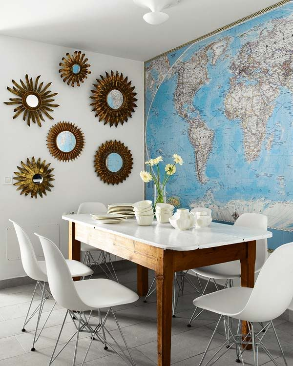dining room. modern chairs. painted white table top. map mural.