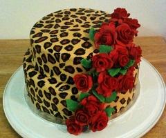 red roses on leopard print cake