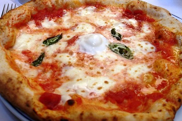 Margherita Pizza at Pizzeria Brandi, Via Chiaia, Naples ~ Pizzeria Brandi was opened in the 19th century, and founder Raffaele Esposito invented the Margherita pizza (made with tomato, basil, olive oil, and fresh mozzarella - the colors of the newly-united Italy's flag) in 1889 when asked to prepare a banquet for Margherita di Savoia, the queen of Italy. The dollop in the middle is mozzarella di bufala (buffalo mozzarella). It was most delicious.