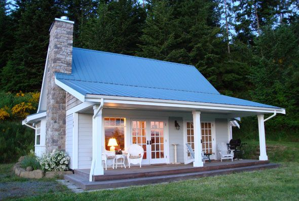 Tin roof cottage. oh yes a tin roof to hear the rain!!  This is my favorite so far. Along with a screened in porch it would be complete!!!