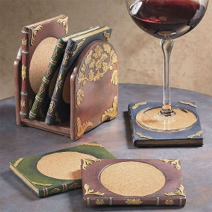 """That's just neat! Set of Six Book Coasters: Our innovative, miniature bookshelf holds a half dozen tiny book coasters. A clever gift for a bibliophile or the hostess of a book club. Handfinished resin coasters have the decorative spines of antique tomes and stack upright in a gilded resin bookshelf. Protective cork inserts. 3 1/2"""" x 5 1/4"""".    ****   Set of Six Book Coasters:     Price:$32.00"""