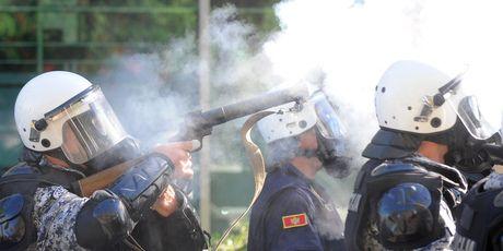 Police in Montenegro fired tear gas to repel anti-gay extremists who threw rocks and firebombs at officers protecting a gay pride march, officials said. About 60 people were injured - New Zealand Herald...
