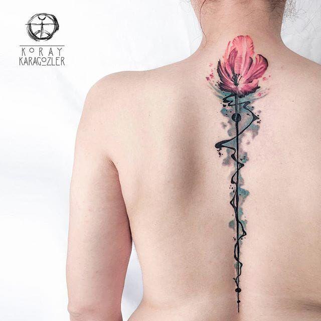 A wonderful long-stemmed flower down the spine by Koray Karagözler (IG— koray_karagozler). #flower #KorayKaragözler #longstemmed #watercolor