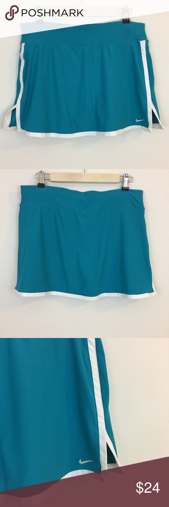 "Nike Running/Tennis/Golf Skort Skirt Nike Running/Tennis/Golf Skort Skirt in a pretty Turquoise color with White accent color.  Side slit and compression shorts under skirt.  Size: Medium Waist: 15.5"" (flat lay) Length: 14"" Nike Skirts"