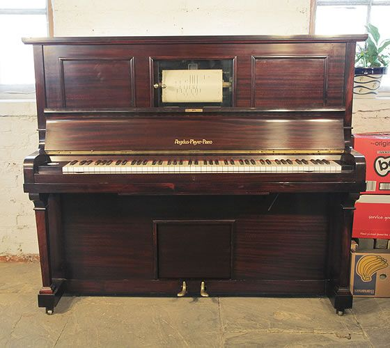 A fully functioning Angelus upright pianola with a mahogany case. Comes with over 180 player rolls. Can be played as a piano or pianola. Piano has an eighty-eight note keyboard and two pedals.