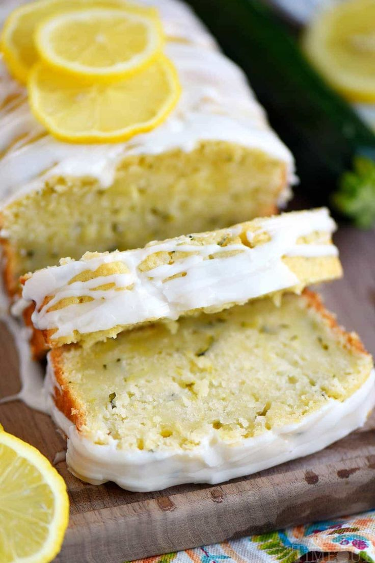Lemon Zucchini Cake - Mom On Timeout-This Lemon Zucchini Cake is so moist, undeniably delicious and topped with a lemon glaze that will keep you coming back for one more slice.