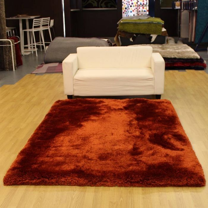 abulous touchyfeely polyester rug in desirably deep supersoft pile a terracotta