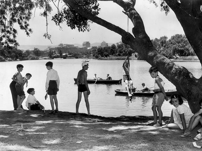Children child play on the banks of the River Torrens in 1951.