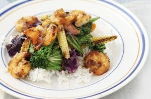 499 cals/17g fat per portionThis Asian prawns stir-fry with jasmine rice is a quick and easy meal to make. With delicious teriyaki sauce and a fresh pack of stir-fried veg, this dish is a healthy mid-week meal and it only takes 15 mins to make.