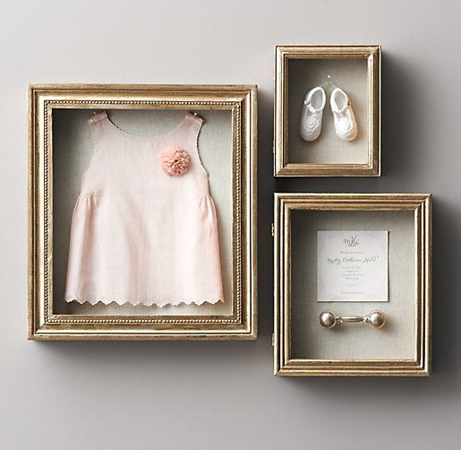 Shadow boxes with sonogram pics, bronzed shoes, certificate of live birth, sophie, umbilical cord, first curl, fetal monitoring