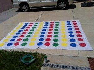 DIY a giant Twister game for your group of friends and anyone you happen to meet. | How To Throw An Epic Beach Party