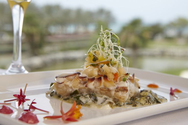 Macadamia Grouper - served with creamed spinach, tropical fruit relish and beurre blanc