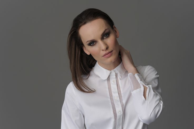 Plain white shirt with necked cuffs and buttoned area by The Shirt Company