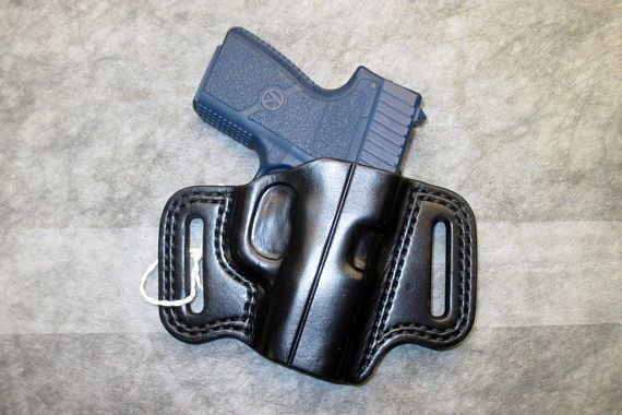 OWB pancake holster for the Kahr PM9, CM9 and other pistols. Right hand with a 15 degree forward cant, rake or angle. 8-9 ounce Wickett & Craig black holster/skirting leather. 9 ounce leather is over 1/8 thick. 1-3/4 X 5/16 belt slots. Slide guard. Double stitched. Hand formed and