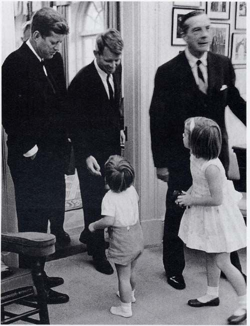 1963. 14 October. President John Fitzgerald Kennedy,  John Jr. Attorney General Robert Kennedy at the White House with Caroline
