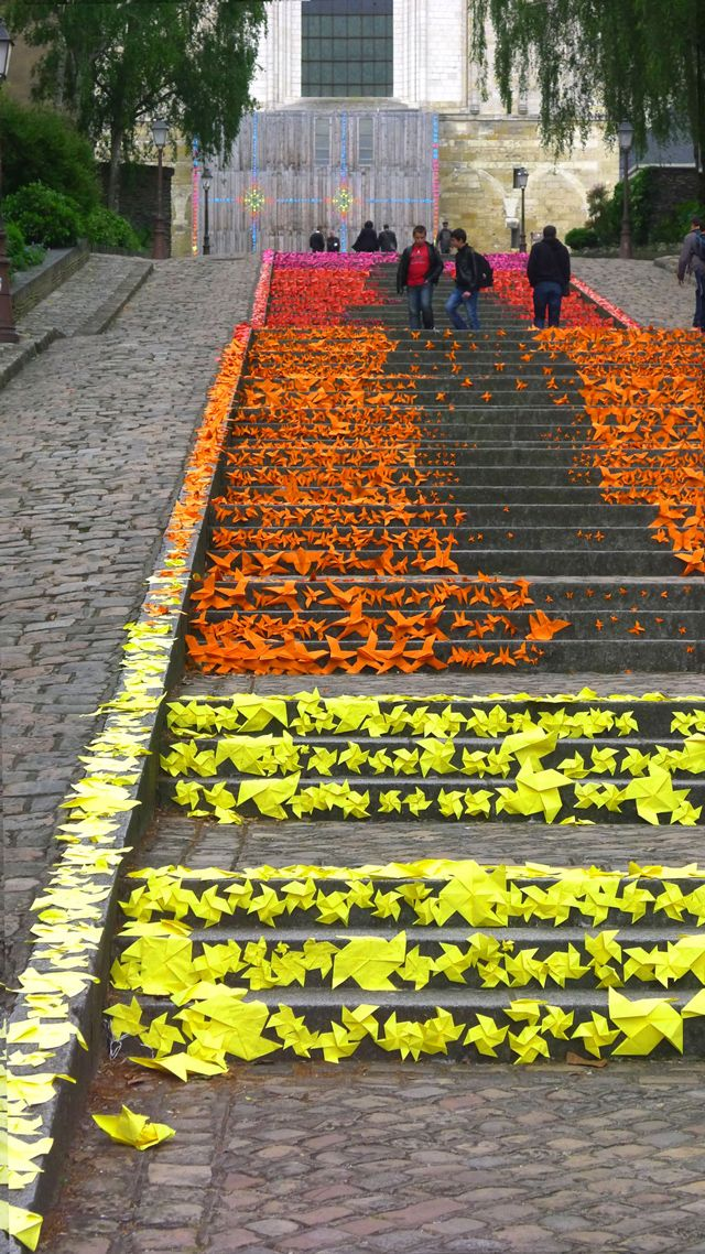 In late May, French artist Mademoiselle Maurice created three colorful origami installations in Angers, France for the ARTAQ 2013 festival.