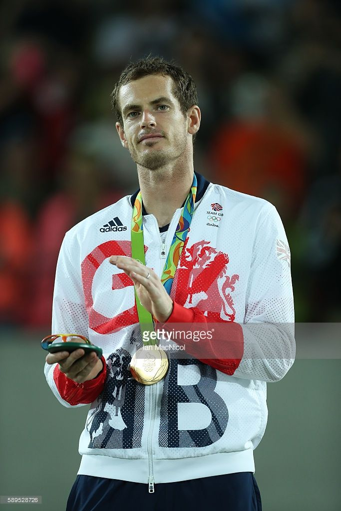 Andy Murray of Great Britain poses with his Gold medal after defeating Juan Martin del Potro of Argentina in the Men's singles final at Olympic Tennis Centre on August 14, 2016 in Rio de Janeiro, Brazil.
