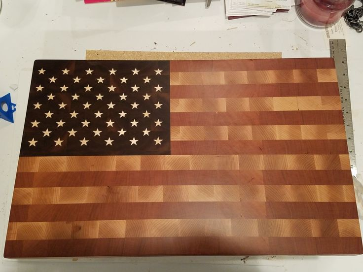 American Flaf butcher block end grain cutting board made of cherry and maple for the stripes, and walnut for the union field with maple stars.