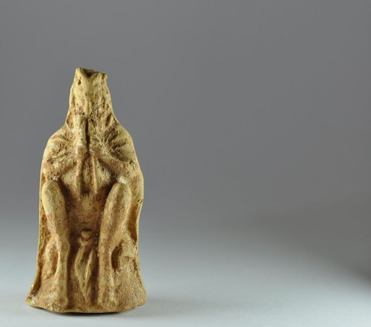 Satyr, Greek satyr playing double flute, 3rd century B.C. Greek terracotta statuette of seated satyr playing double flute, draped, with phallus exposed and tail, 12 cm high. Private collection