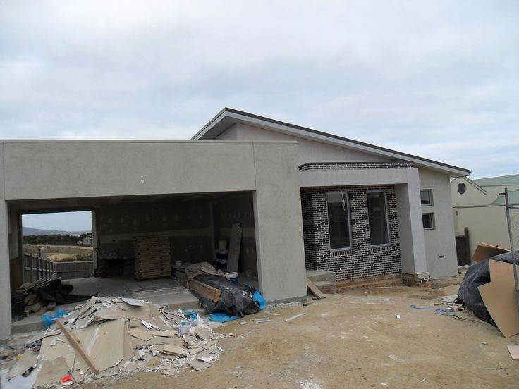 54 Park Rd. - render base coat being applied. Blade wall erected.