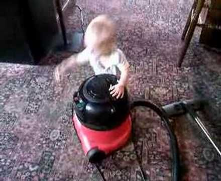 funny cute baby loves henry hoover