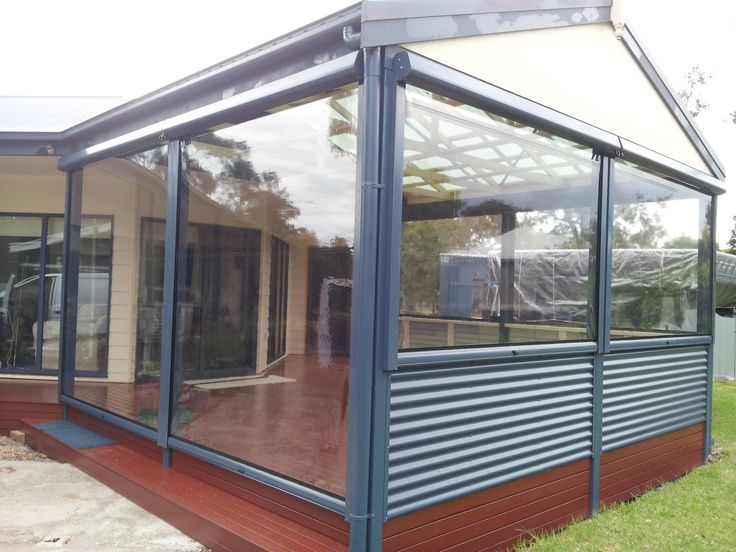 Clear Vinyl Panel Blinds Fully Enclosing an Outdoor Entertainment Area.