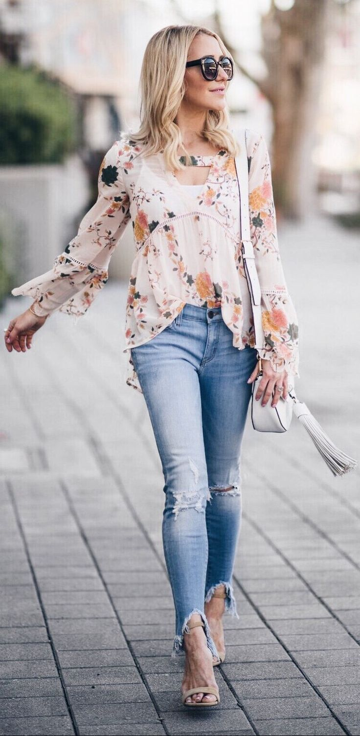 #spring #outfits  White Floral Blouse & Ripped Skinny Jeans