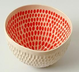 I like this bowls vibrant colour on the inside where we would normally see it on the outside, this make it different and unique. I like the texture of the bowl which looks as if its pushed in to give a bumpy texture.