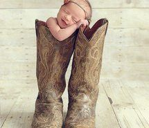 Newborn baby photo in cowboy boots cutebaby cowboyboots babypictures