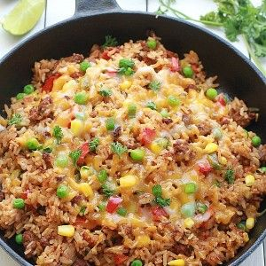 {One Pan} Mexican Rice Skillet - An easy Mexican rice dish made all in one pan in as little as 30 minutes.