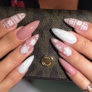 Instagram photo by malishka702_nails - nude polish base with white snowflake design over the top stiletto nail art...x