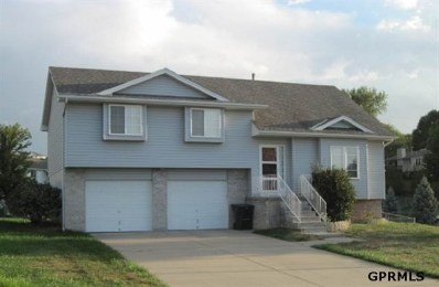 Pretty Multi-level home in convenient area of Bellevue, NE, just minutes from Offutt Air Force Base! Open floor plan with vaulted ceilings, gas log fireplace, deck off the dining area, walk out from lower level family room and a garage large enough for full sized truck PLUS all yard equiptment! Please share!     727 Grenoble Dr, Bellevue, NE 68123 SOLD!!!!