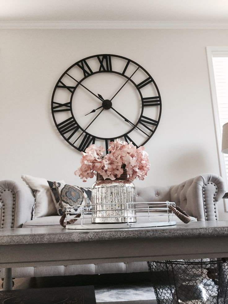 Details : thelilliebag.com  |decorating ideas, living room decor . Rustic decor meets glam, oversized clock , tufted sofa , gray and blush decor.  Mercury glass accessories.  Nailhead sofa.  Living rooms.