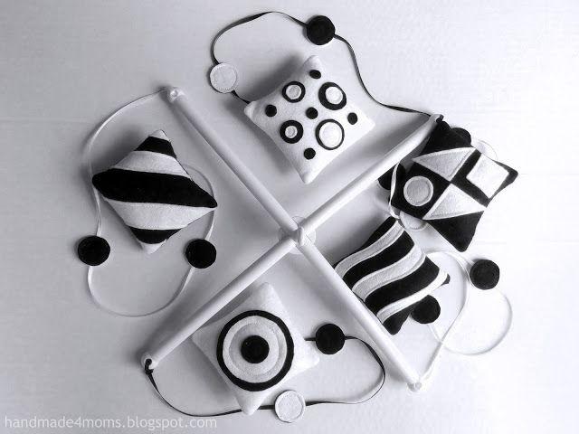 черно белый мобиль для новорожденног