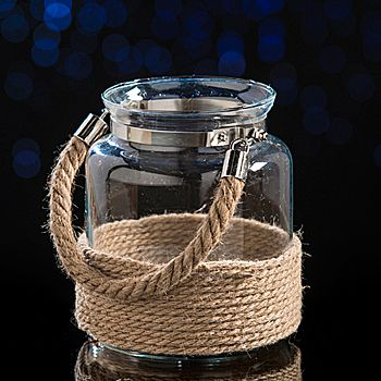 Create a unique look on your tabletops when you add these Rustic Lantern Centerpieces wrapped in twine featuring a rope handle.