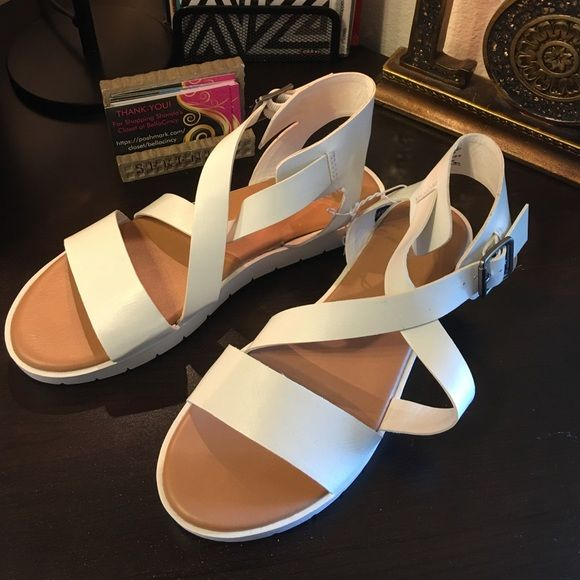 Old Navy white sandals New with tags. Cute and comfortable. Versatile look and color. Synthetic material. Have sizes 7, 8 and 10. Fits true to size. Old Navy Shoes Sandals