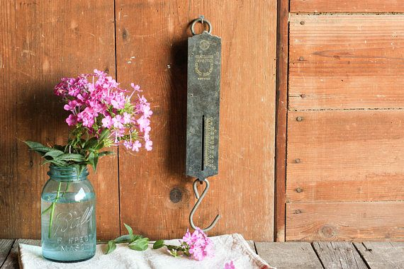 This vintage hanging scale is an quaint piece that will instantly remind you of an old country grocery store. Use this Industrial kitchen wall decor as the perfect Farmhouse kitchen scale or rusty metal wall decor!