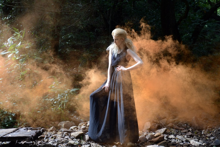 strong model pose in the forest with orange smoke flare  www.kelliannephotographer.co.uk
