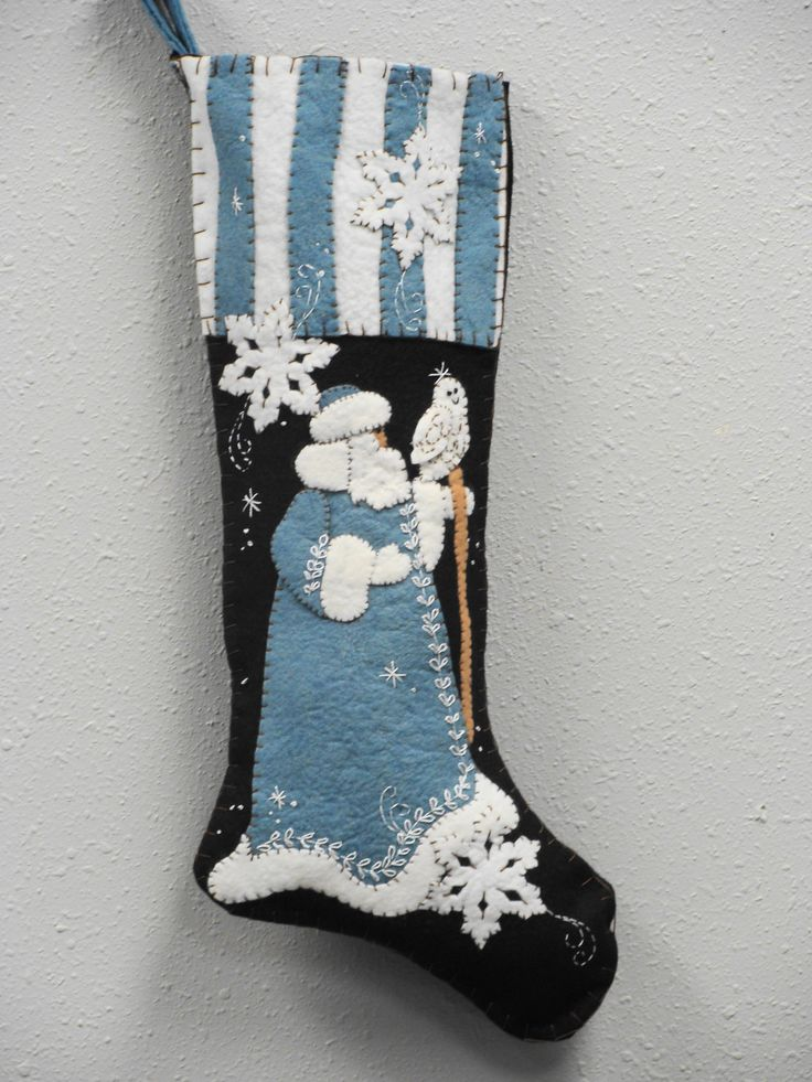 """CD75 Blue Santa ,, 25"""" long applique stocking , heirloom quality .A new color coat and topper on a vintage favorite ! We have both patterns and kits and the kits include the pattern . The kits include wool felts that are washed and ready to use and felted very nicely to add that dimensional look ."""