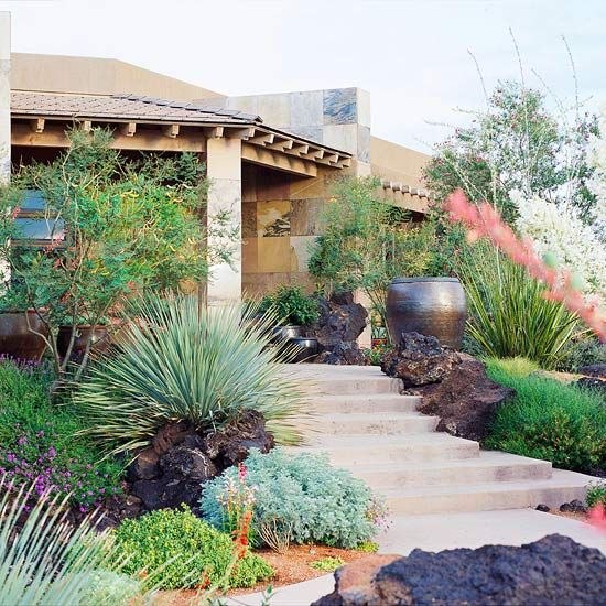 Plantings, rock and container plantings accent and beautify the path to the front door.