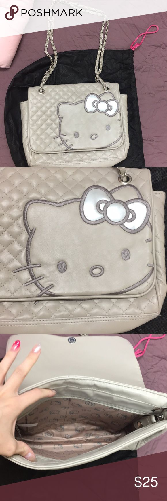 Hello kitty purse Grey. Almost new! Clean inside. Little smudge on back which I…