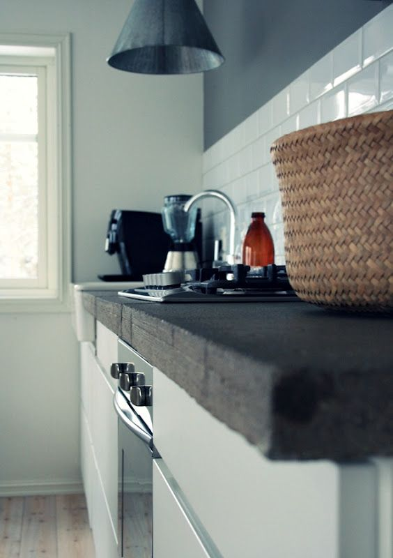concrete counters, subway tile, grey wall, blonde floorboards. love
