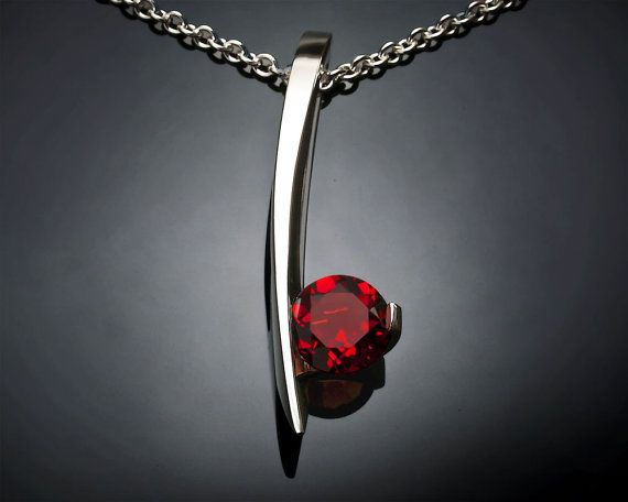 Argentium silver and Mozambique garnet pendant designed by David Worcester for VerbenaPlaceJewelry.Etsy.com