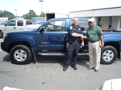Folger Subaru Sales Consultant Bill Barber with one of Charlotte's Finest, Officer Riggins, and his 2007 Toyota Tacoma PreRunner V6 pickup truck!