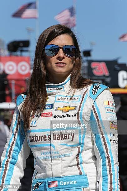 Danica Patrick driver of the Nature's Bakery Chevrolet looks on in the garage area during practice for the NASCAR Sprint Cup Series Daytona 500 at...