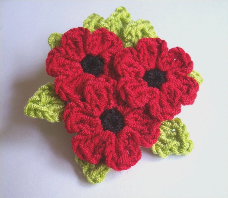 Red Poppy flowers with green leaves bouquet crochet brooch.