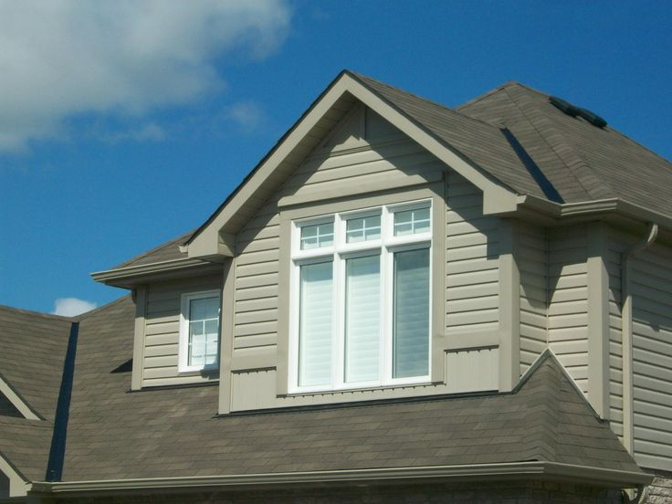 Example of dormers cladded in insulated vinyl cladding.