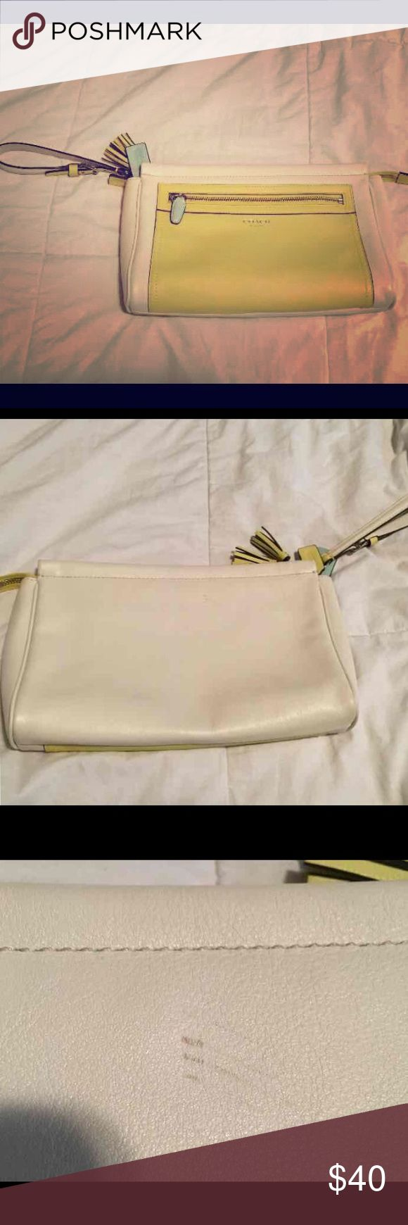 Coach legacy clutch Leather Coach legacy tassel clutch great condition ... purchased from another posh never used it ... never been out of my house only mark is a small spot on the back (see pic) Coach Bags Clutches & Wristlets