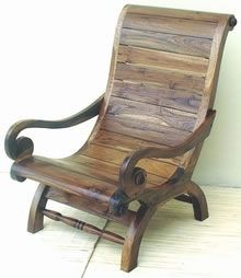 this chair is teak- great for outdoor environments.  i love the graceful lines and it looks comfortable as well.